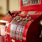 Red old-time cash register in a shop